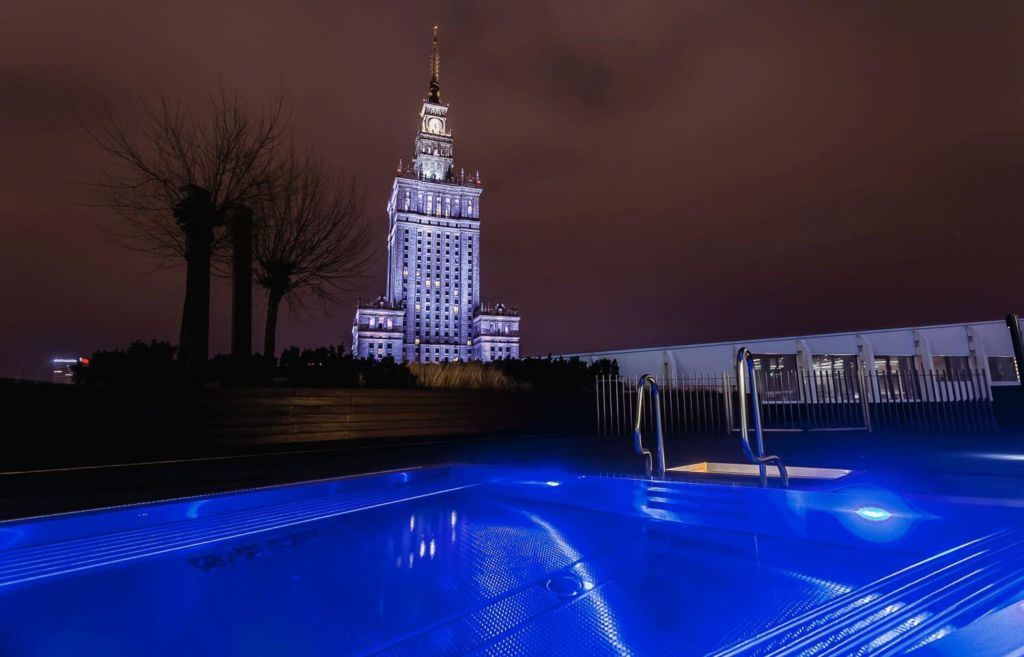 outside swimming pool on zlota 44 with the view on Palace Of Culture And Since